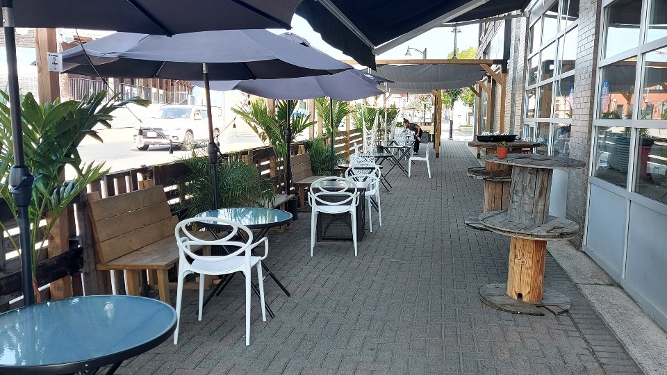 The outdoor patio has expanded.  It is a shared yet divided space with people walking in the area and also beautified like the inside setting.