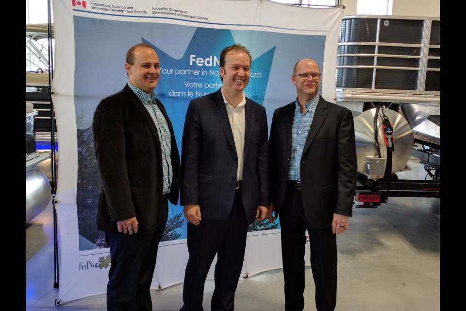 Sudbury MP Paul Lefebvre, centre toured Legend Boat's facility in Whitefish with company managers Jamie Dewar, left, and Marc Duhamel, right. Lefebvre announced a $203,306 FedNor loan to the company to help it improve its technology systems. Photo by Jonathan Migneault.