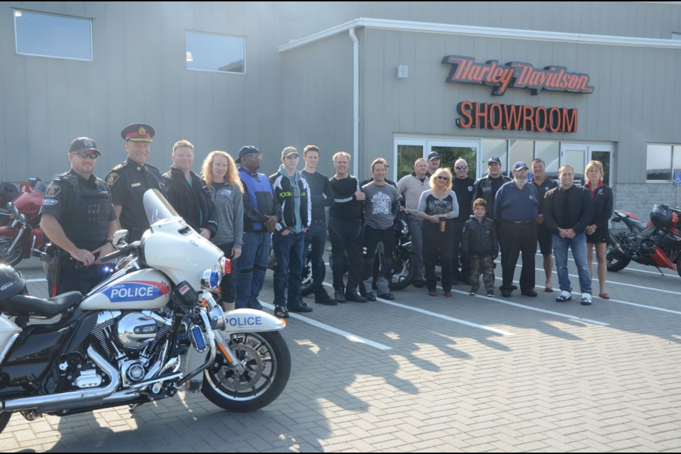 Motorcycle enthusiasts gathered at The Rock Harley-Davidson for Greater Sudbury's third Motorcycle Torch Ride on Aug. 26. (Photo: Arron Pickard)