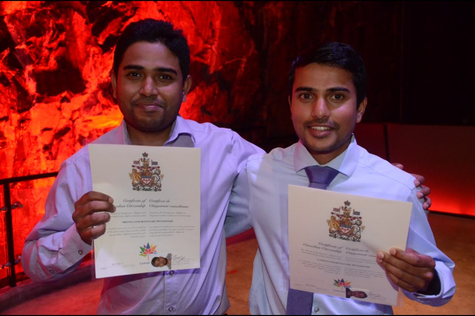 Brothers Nirangu Munasingh and Lashan Munasingh were among the 52 people from 24 countries sworn in Aug. 17 as Canada's newest citizens. (Arron Pickard/Sudbury.com)