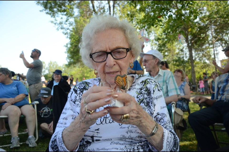 Jeannine Albert released three butterflies on Sunday in memory of her husband, Laurent, her brother in law, Pete Larose, and her niece, Lise Larose. (Arron Pickard/Sudbury.com)