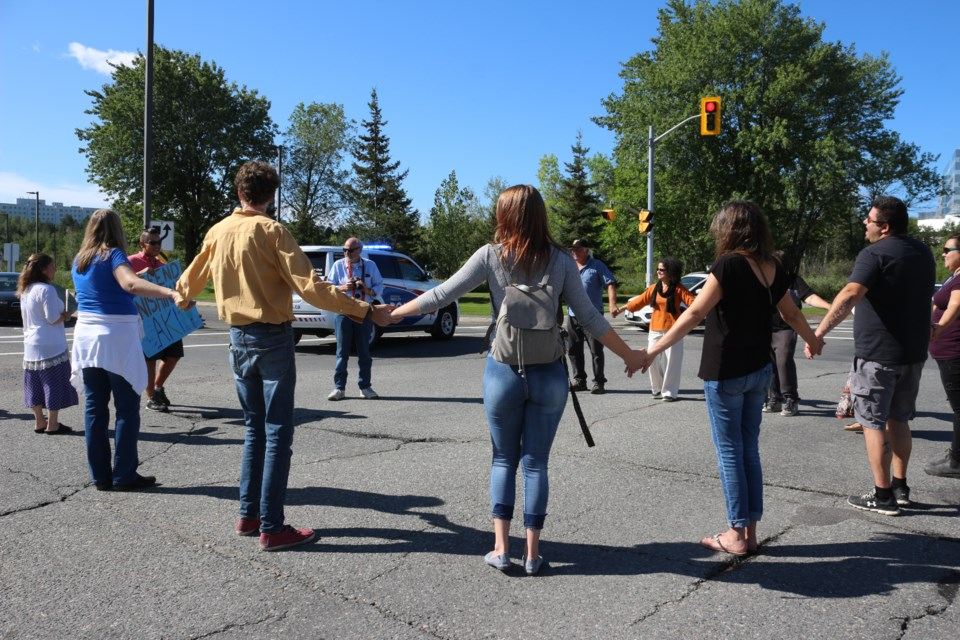 Two round dances were scheduled to take place at the Stop the Ring of Fire – Water is Life demonstration on Ramsey Lake Road on September 6. Only one occurred, stopping traffic for three minutes at 11 a.m. that morning. (Allana McDougall/Sudbury.com)