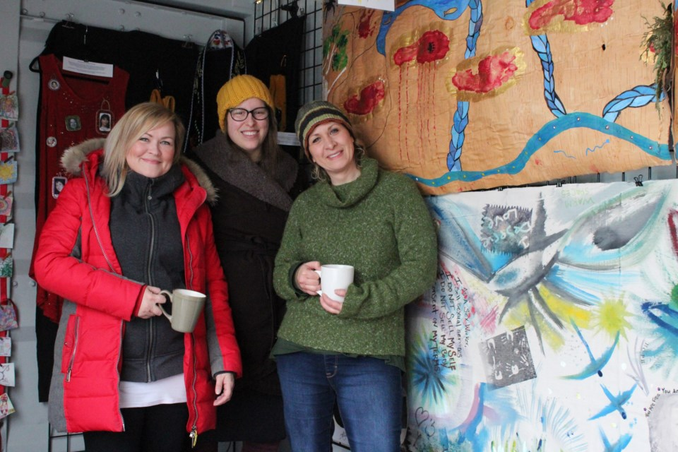 From left, Sarah Gartshore, director and playwright for project ArmHer; Cait Mitchell, facilitator and media artist for project ArmHer; and executive director of SWANS Tracy Gregory at Sexual Assault: The Roadshow on Sunday. (Keira Ferguson/ Sudbury.com)