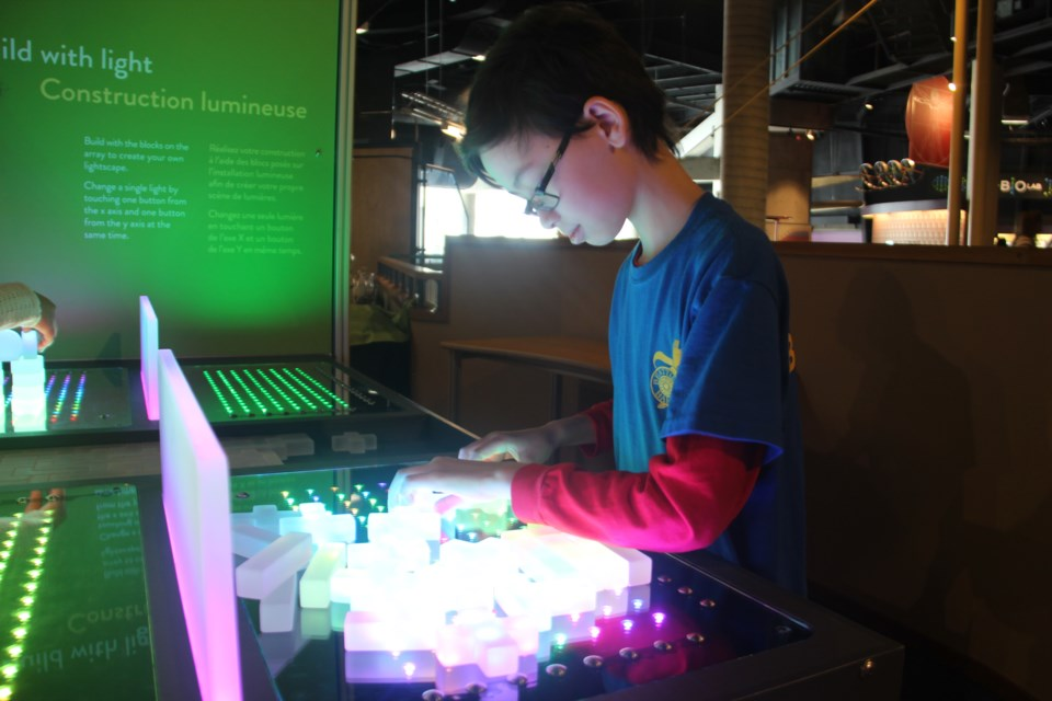 R.L. Beattie Public School student Henry Xiong checks out one of the new exhibits on Science North's fourth floor. (Heidi Ulrichsen/Sudbury.com)