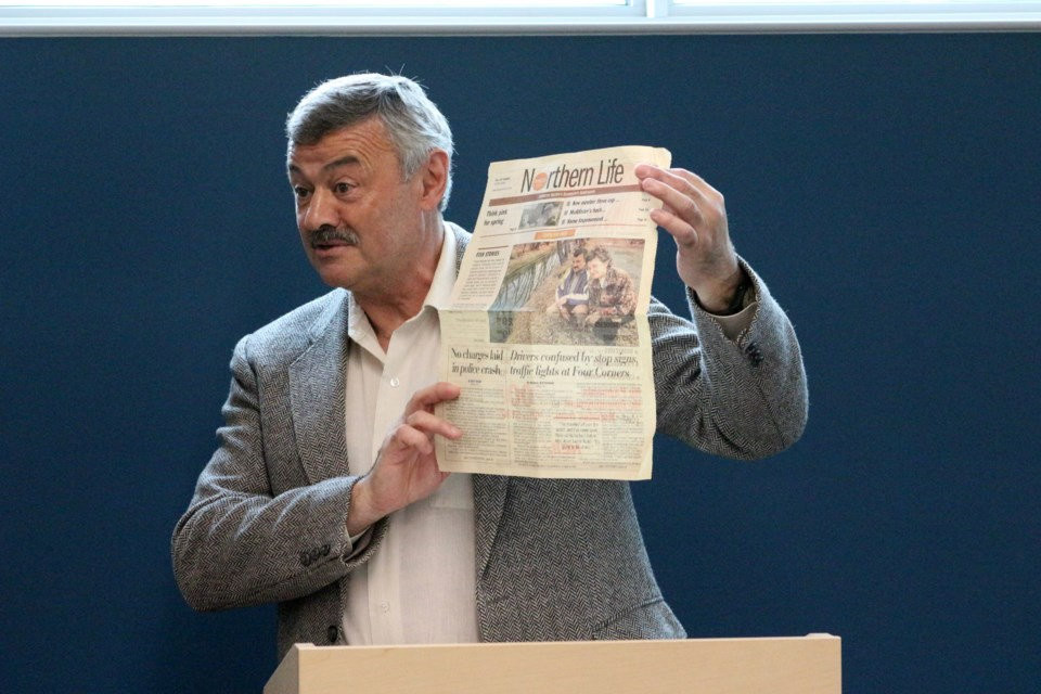 One of the original founders of the Junction Creek Stewardship Committee, Franco Mariotti, holds up the April 21, 1999 edition of Northern Life, which was the day before the committee was officially formed. (Heather Green-Oliver/Sudbury.com)