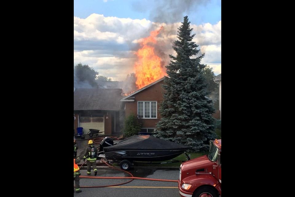 Fire destroyed multiple homes on Ravina Avenue in Garson June 21. (Lauren Carlson)