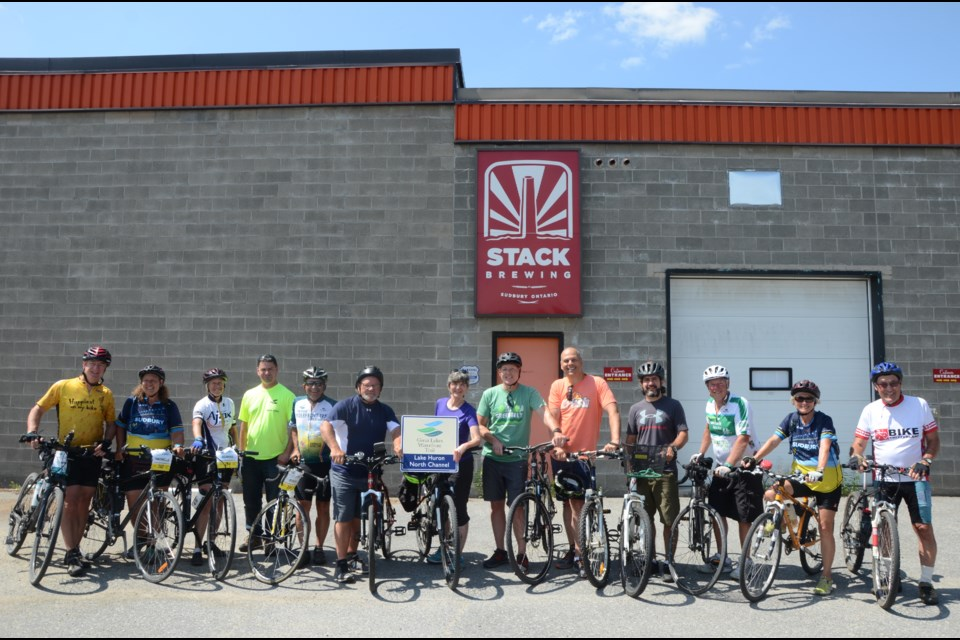 Participants in the Great Lakes Waterfront Trail Adventure met Mayor Brian Bigger and Sudbury MPP Jamie West at Stack Brewing on Kelly Lake Road to kick off the final leg of their 450-km trek. (Arron Pickard/Sudbury.com)