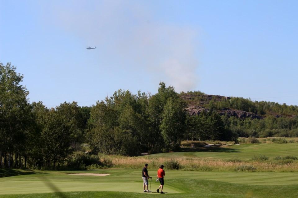 Forest fire found behind the Timberwolf Golf Club property Aug. 25. (Keira Ferguson/ Sudbury.com)