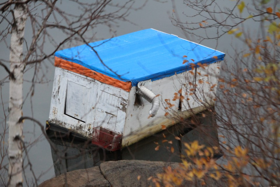 A lone ice hut is still marooned near the shore of Kelly Lake off Southview Drive, where it has been since the ice melted more than six months ago. (Matt Durnan/Sudbury.com)