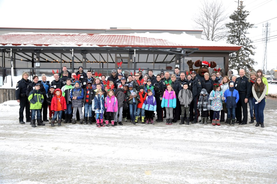 Members of the Greater Sudbury Police Service pair up with local children for the annual Shop with a Cop event. (Supplied)