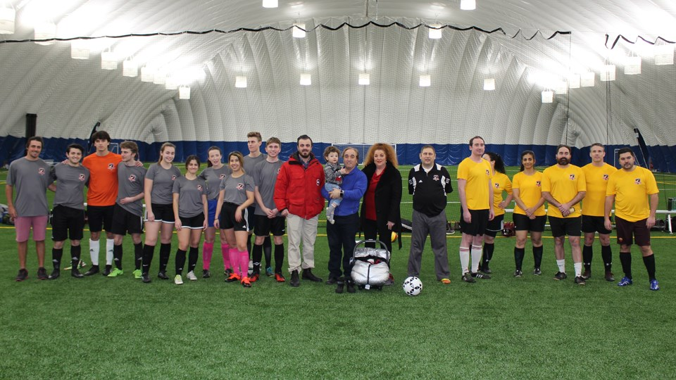 Smiles all around in this photo from February, when the first official soccer game was held at the sports dome on Lasalle Boulevard in New Sudbury. (Matt Durnan/Sudbury.com)