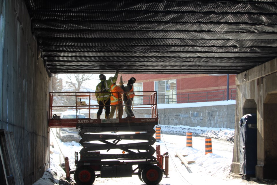 A contractor is going to spend the next four weeks installing netting under the 90-year-old College Street underpass to prevent flaking concrete from falling into the street. (Matt Durnan/Sudbury.com)