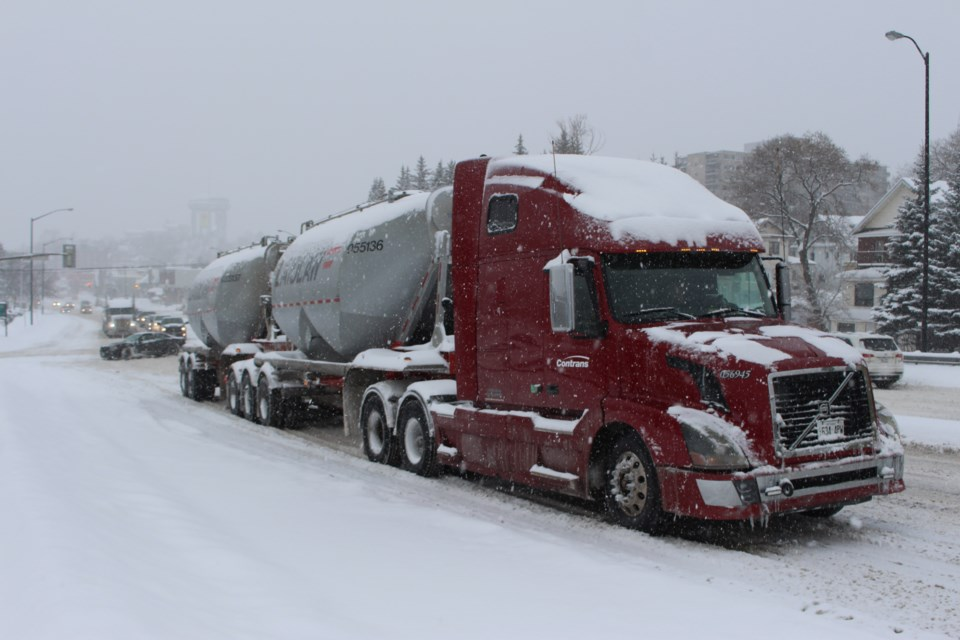 Two transport trucks stuck in the southbound lane on the Bridge of Nations. (Keira Ferguson/ Sudbury.com)