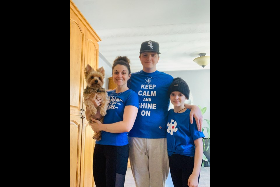 Céleste Séguin and her two children (Joshua Gobeil who has autism and Naomi Gobeil) celebrating Autism Awareness Day. Of course Jasper, their dog wanted in on the action!