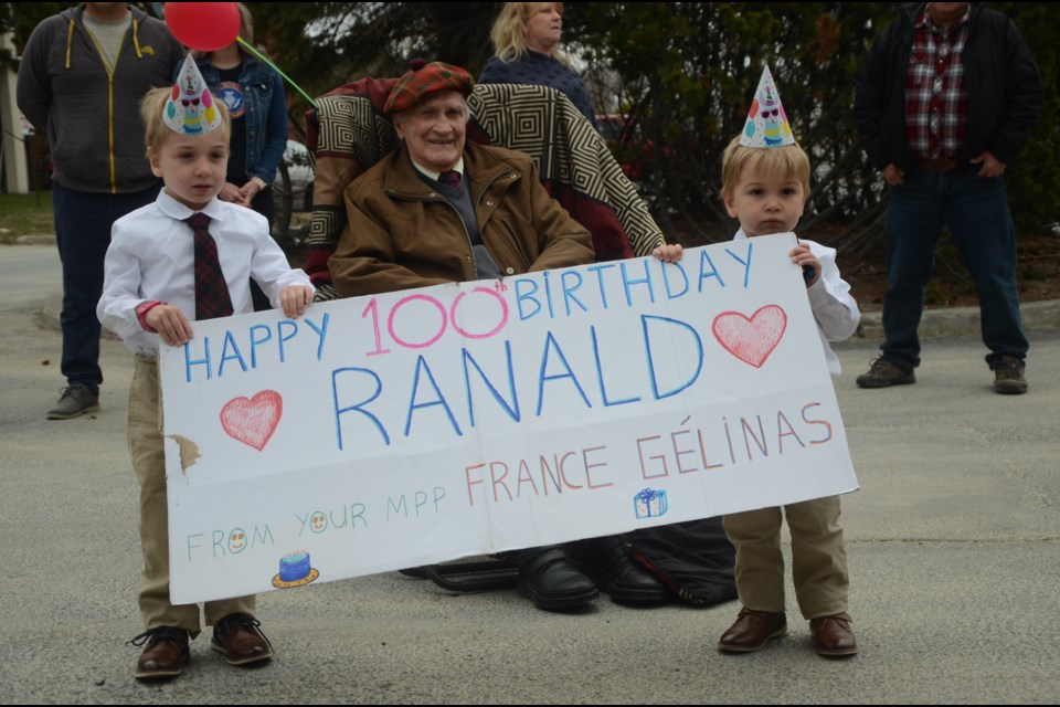 Ranald MacDonell celebrated his 100th birthday on May 14 with family including his great-grandsons Nolan, 5, and Leon, 2. (Arron Pickard/Sudbury.com)