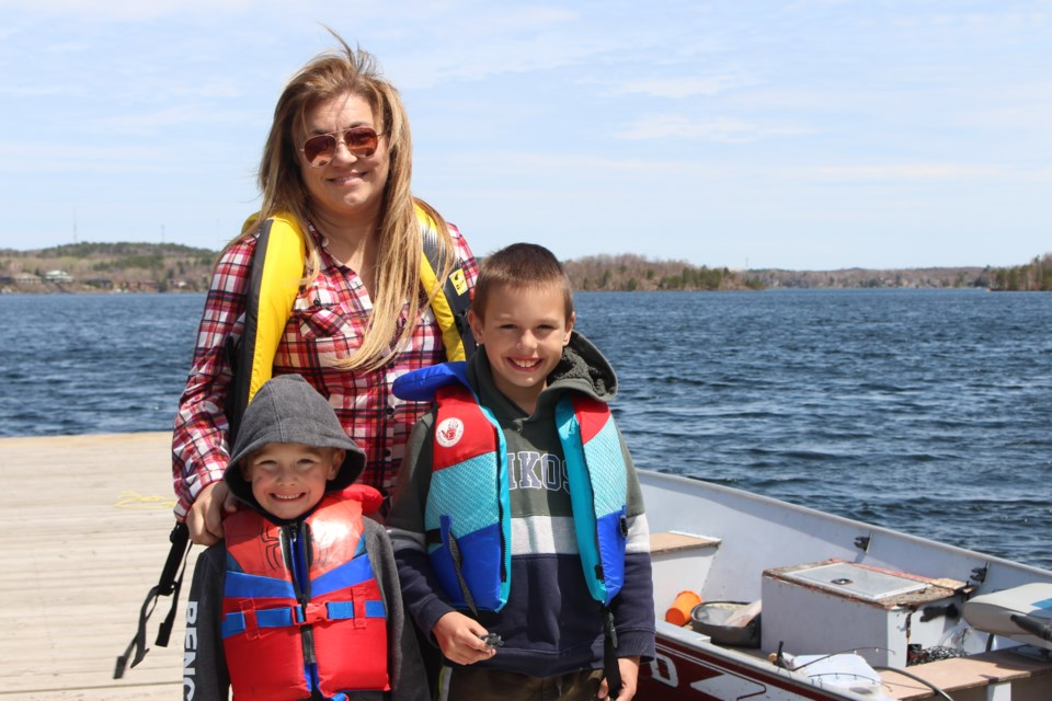 (From the left) Zander Rouleau, Michelle Cacciotti and Gavyn Rouleau at the Ramsey Lake boat launch. (Keira Ferguson/ Sudbury.com)