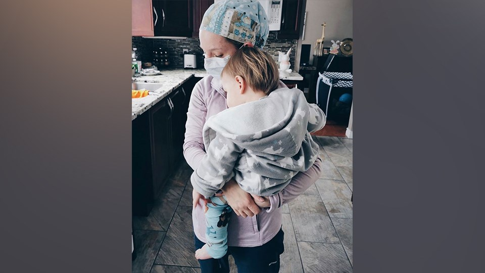Kayla Crump is a registered nurse at Health Sciences North. This photo was taken as she was getting ready for a 12-hour night shift and her son wanted a hug from mommy before she left for work. (Supplied)