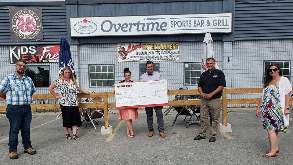 Pictured from left to right: We the Bury team member Riley Mignacca, Jana Schilkie of Jana Hospitality Consulting, We the Bury team members Ashlie Wainman and Curtis Loiselle, Overtime Sports Bar and Grill representative Attilio Langella and Dayna Caruso of Northern Ontario Families of Children with Cancer. (Supplied)