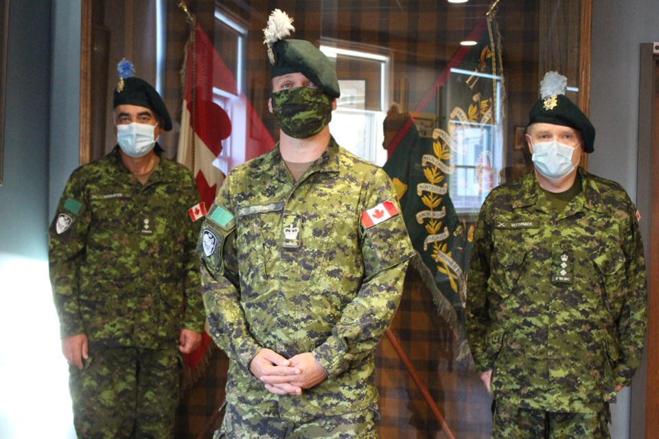 Warrant Officer Michael Young (centre) with honourary Lt. Col Abbas Homayed (left) and honourary Col. Kevin McCormick. (Matt Durnan/Sudbury.com)