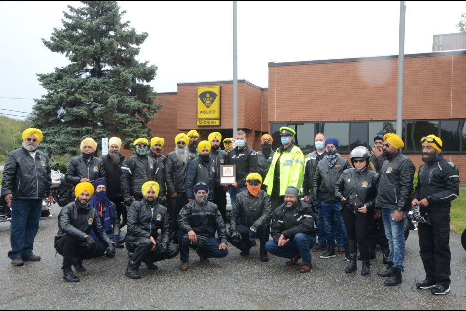 About two dozen members of the Sikh Motorcycle Club of Ontario roared into Greater Sudbury on Saturday to show first responders in the city their appreciation, including the OPP on Highway 69. (Arron Pickard/Sudbury.com)