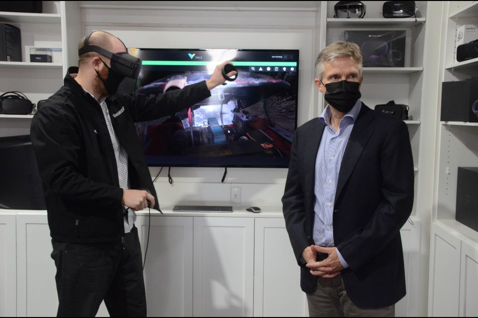 Finance Minister Rod Phillips gets a demonstration of virtual reality technology from NORCAT's studio manager, Andrew Kostuik, during a tour on Friday. (Arron Pickard/Sudbury.com)