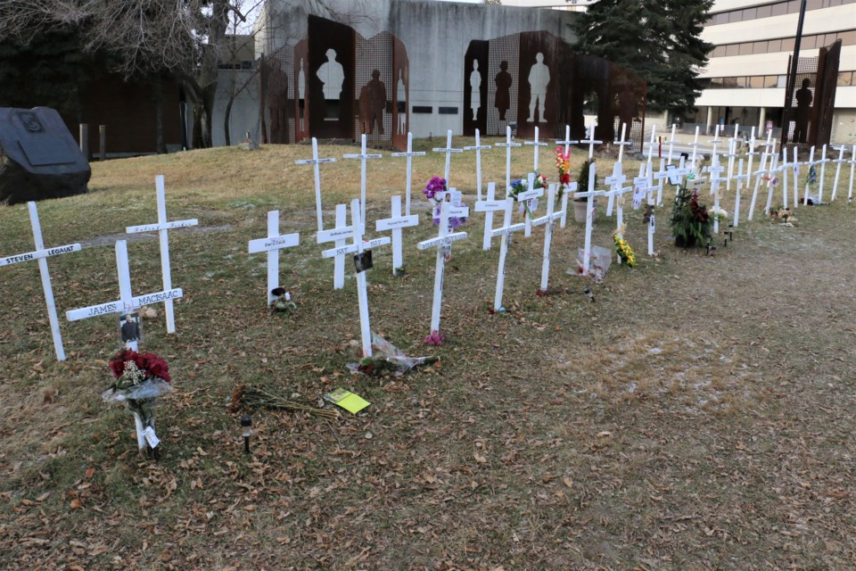 Nearly 80 white crosses are now installed on a patch of land in downtown Sudbury to raise awareness of mental health and addiction problems. Denise Sandul is the mother of an opioid victim. She began the memorial and said there is a crisis in Sudbury.  She said more provincial money is needed to improve access and treatment. (Len Gillis / Sudbury.com)