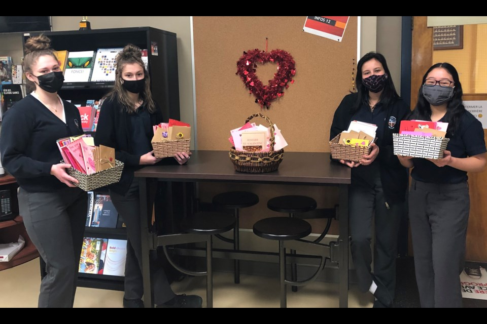 Collège Notre-Dame students with some of the Valentine's Day cards they created for Extendicare York residents. (Supplied)