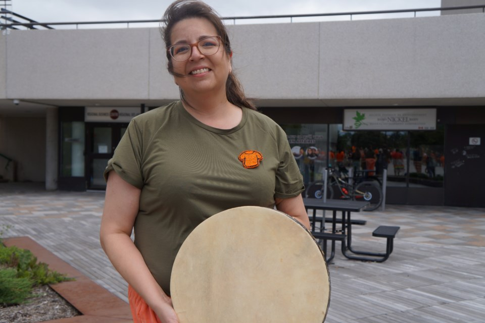 Heidi Manitowabi sang and played her drum to open the rally.