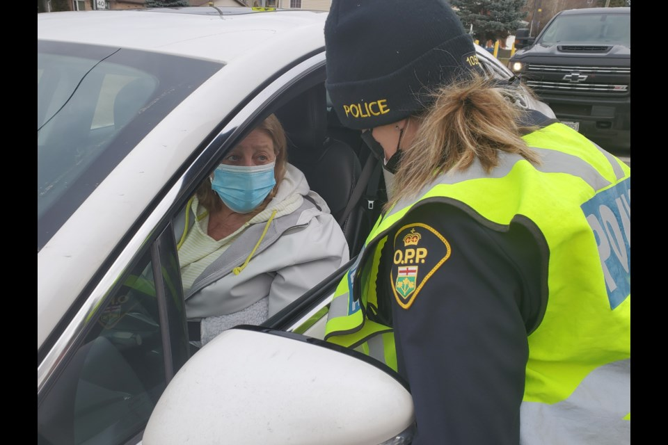Ontario Provincial Police Const. Nicole Nicklasson thanks a driver for being sober during the Festive RIDE launch on Nov. 27. (Arron Pickard/Sudbury.com)
