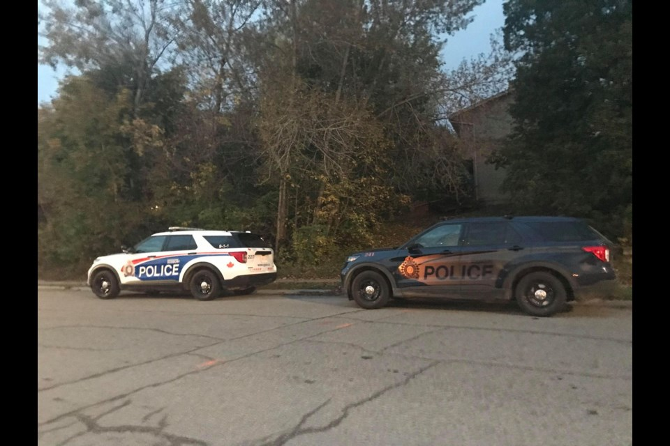 Unoccupied Greater Sudbury Police vehicles were parked outside of a fatal shooting site on Bruce Avenue Oct. 11.