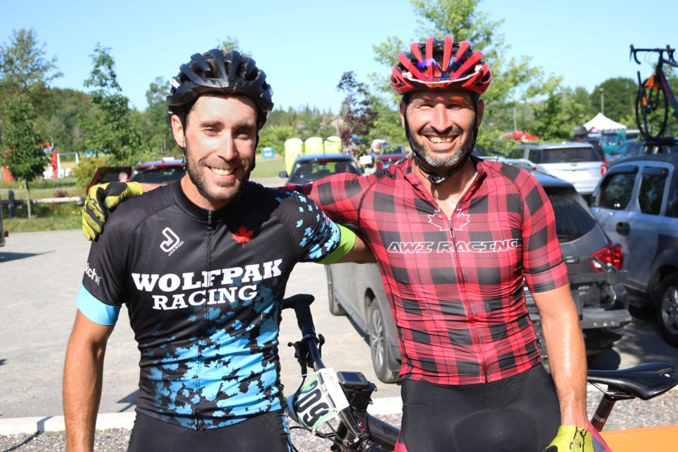 (From the left) Paul Guenette, from Team Wolfpack of the Walden Mountain Bike Club and Matthew Spak, from the international AWI racing team, at day three of XTERRA: Conquer the Crater at Kivi Park. (Keira Ferguson/ Sudbury.com)