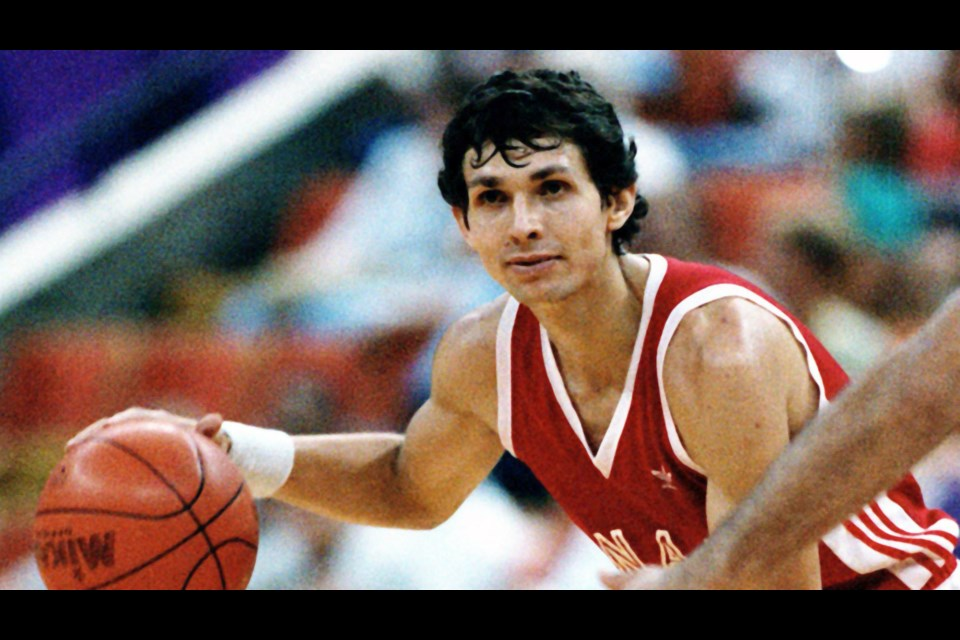 A young Eli Pasquale surveys the court during a game at the 1984 Olympic Games in Los Angeles, California. (Library and Archives Canada)