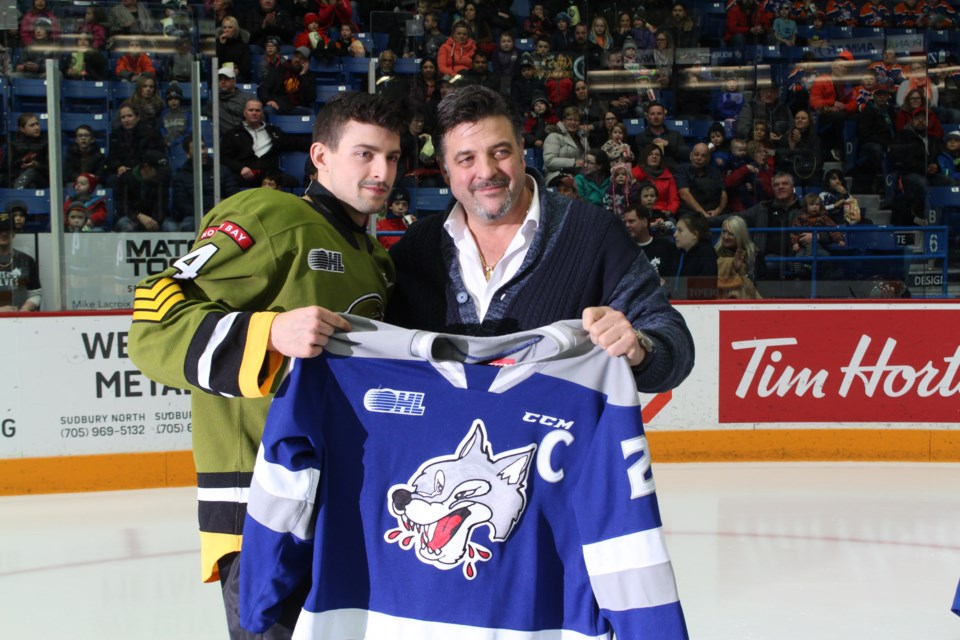 Dario Zulich bids farewell to Shane Bulitka as he leaves Sudbury to join the North Bay Battalion. (Matt Durnan/ Sudbury.com)