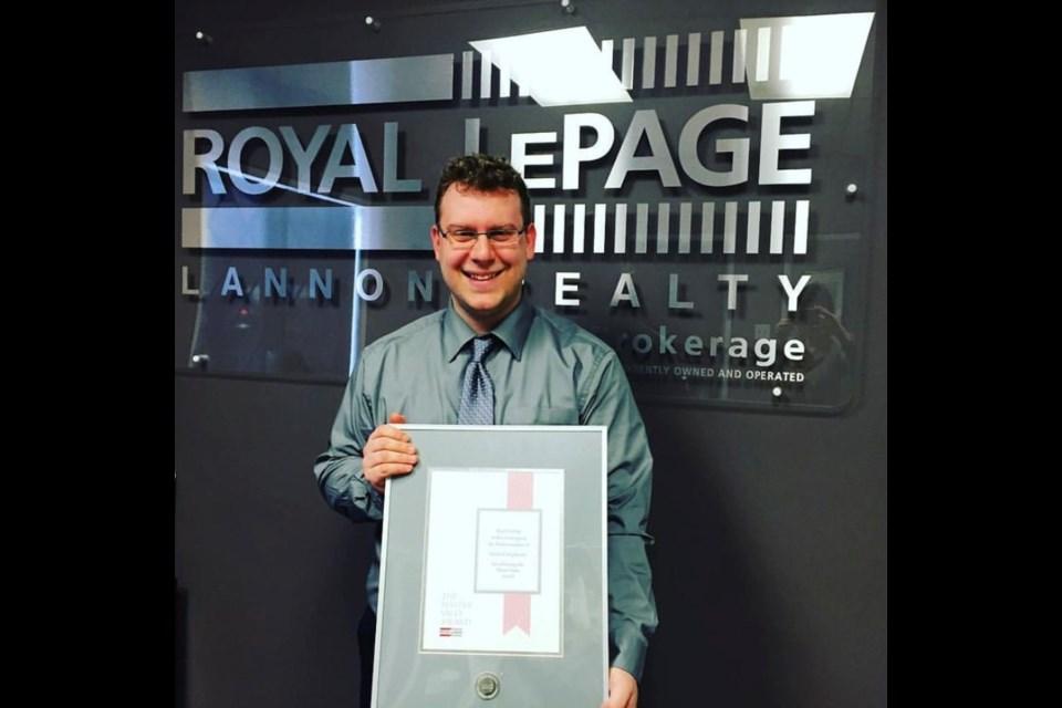 Realtor James Colquhoun celebrates after receiving his first sales award.