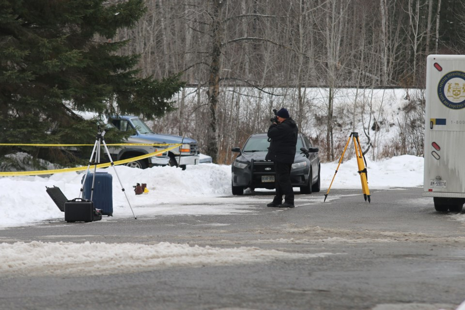 Members of the Special Investigation Unit comb over the scene Sunday afternoon of a fatal police shooting Satruday night in Nipigon. (Doug Diaczuk - tbnewswatch.com).