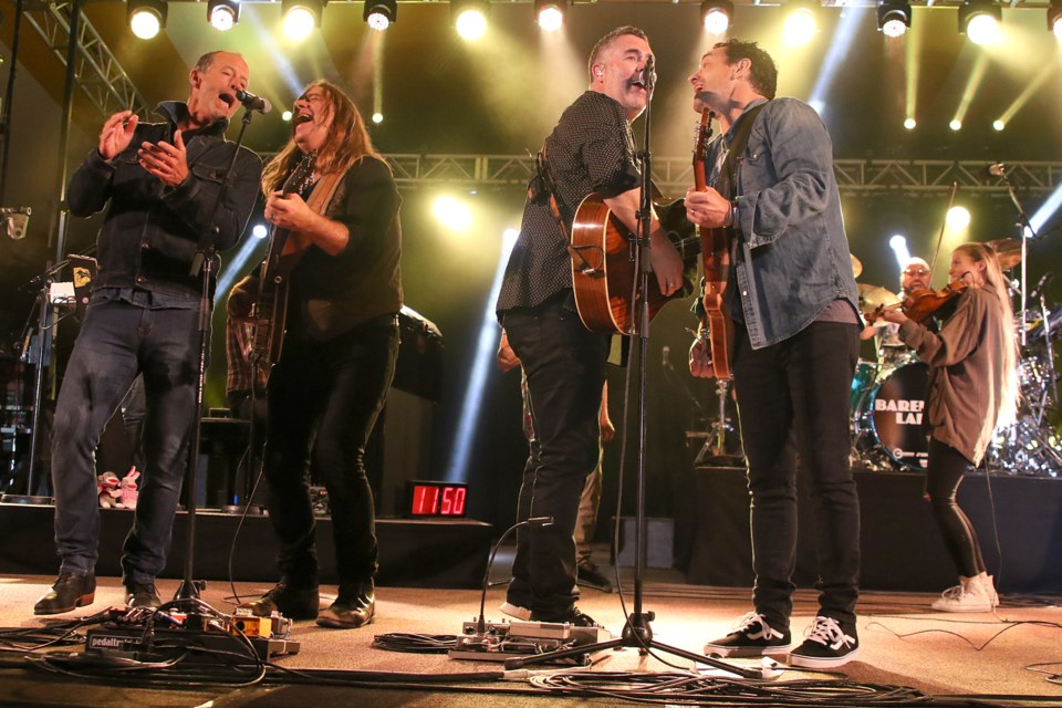 Barney Bentall (left) and Alan Doyle join the Barenaked Ladies on stage at the Thunder Bay Blues Festival on Saturday, July 8, 2017 at Marina Park (Leith Dunick, thnewswatch.com).