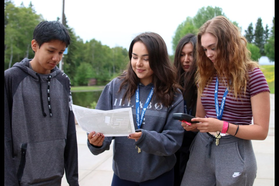 Deiken Turtle, Zoey Sawdo, Kaley Kakegamic, and Emily Ottertail practice using a GPS during a geocaching exercise at Lakehead University during the Outland Youth Employment Program. (Photos by Doug Diaczuk - Tbnewswatch.com).