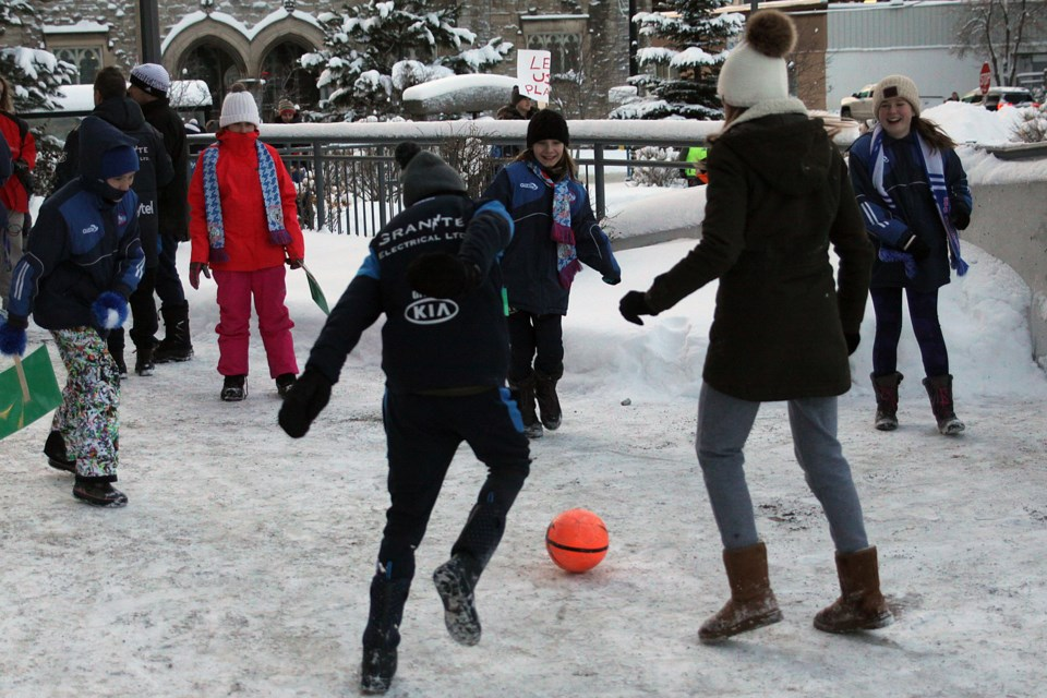 Children play soccer in front of Thunder Bay city hall before the council meeting on Monday, January 15, 2018. (Matt Vis, tbnewswatch.com)