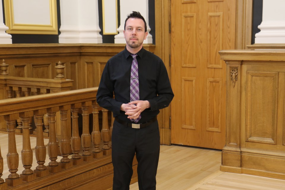 Thunder Bay Courthouse Hotel general manager Chris Kowbuz says the former courtroom has kept both the juror's box and the judge's table. (Leith Dunick, tbnewswatch.com