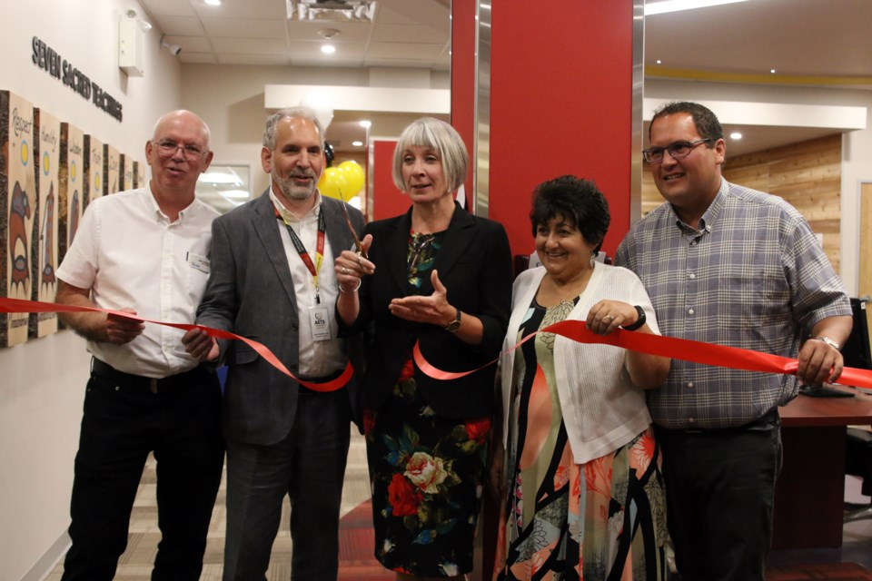 From left to right: Chief librarian, John Pateman, AETS executive director, John DeGiacomo, Minister Patty Hajdu, Sharon Ostberg, president of the AETS Board, and Matthew Dupuis, chief of the Red Rock Indian Band, cut the ribbon to open the AETS centre at the Waverley Resource Library. (Photos by Doug Diaczuk - Tbnewswatch.com).