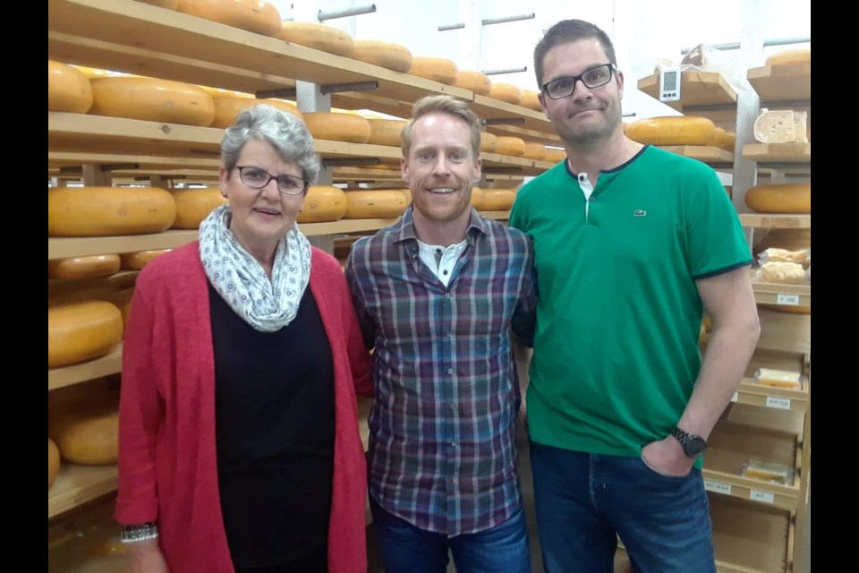 Margaret Schep, Amazing Race host Jon Montgomery, and Walter Schep from the Amazing Race Canada's visit in May. (Facebook / Thunder Oak Cheese Farm)
