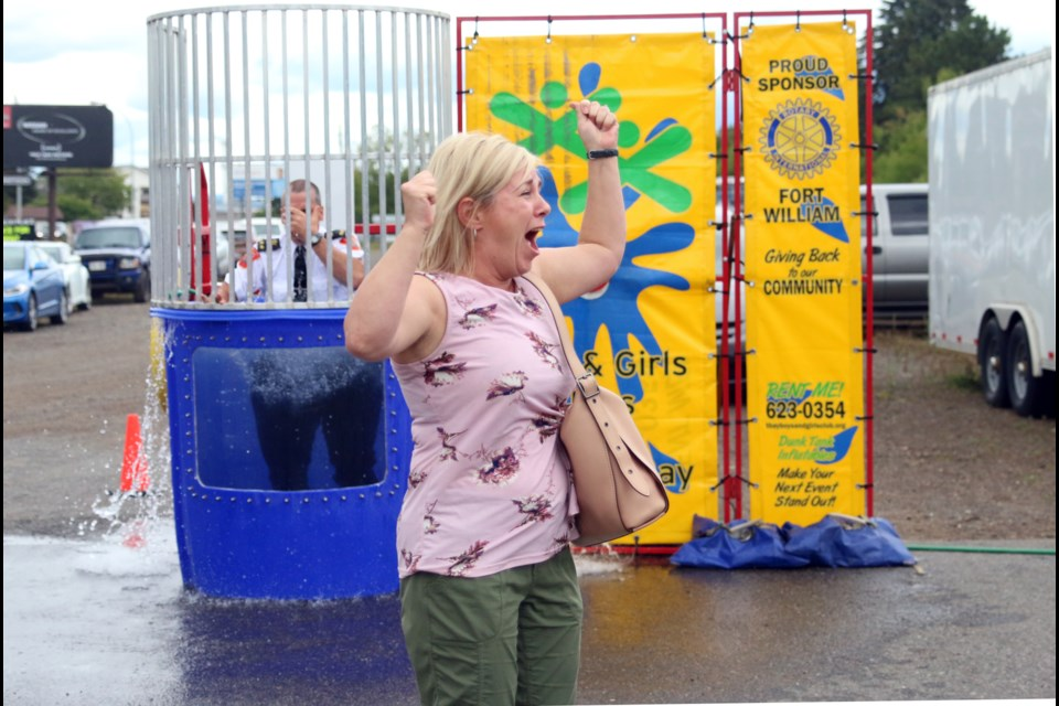 Jennifer Hughes cannot contain her excitement after successfully dunking her husband, Thunder Bay Police Service deputy chief, Ryan Hughes. (Photos by Doug Diaczuk - Tbnewswatch.com).