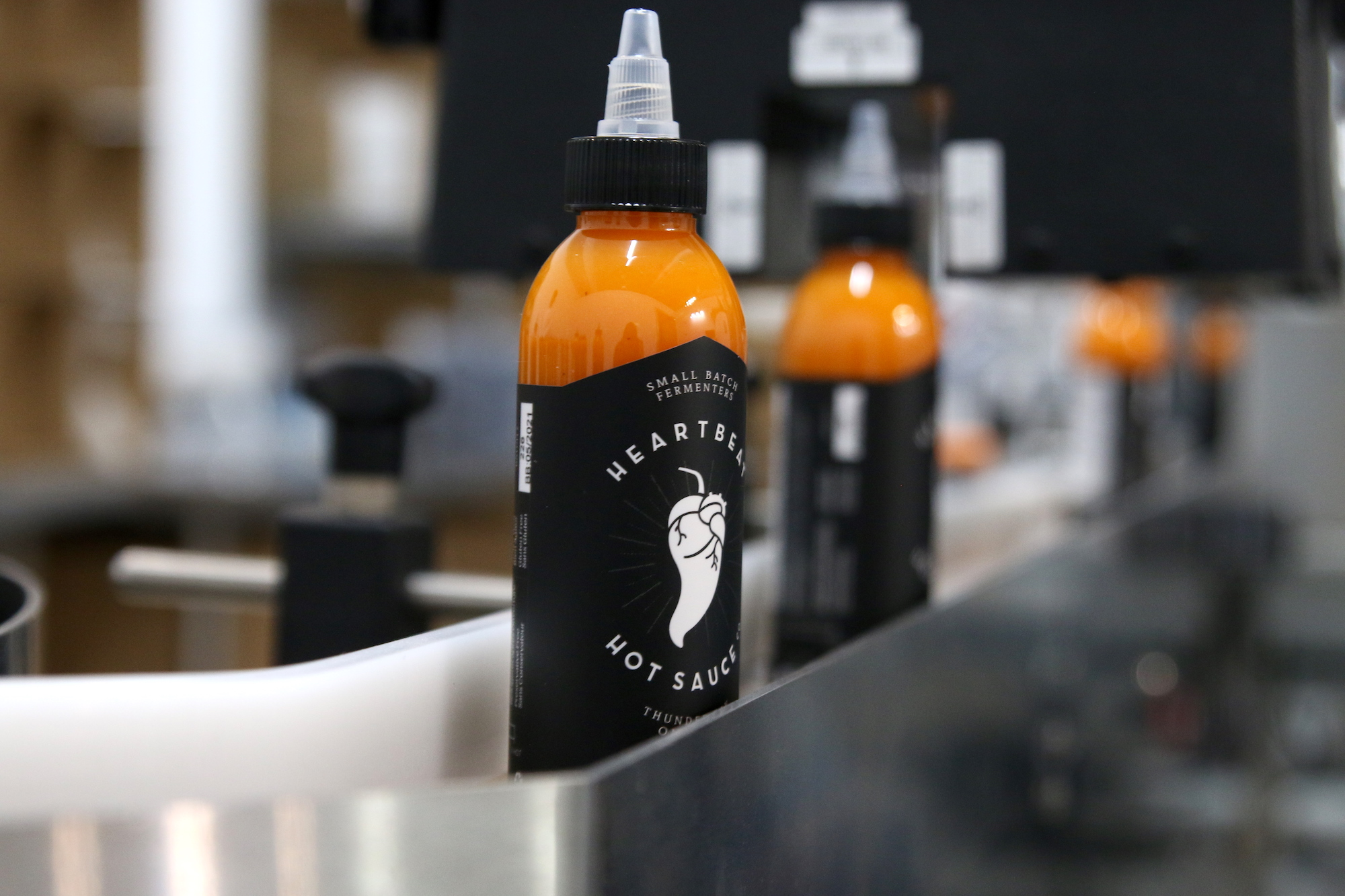 Local hot sauce company expands to larger location (5 photos)