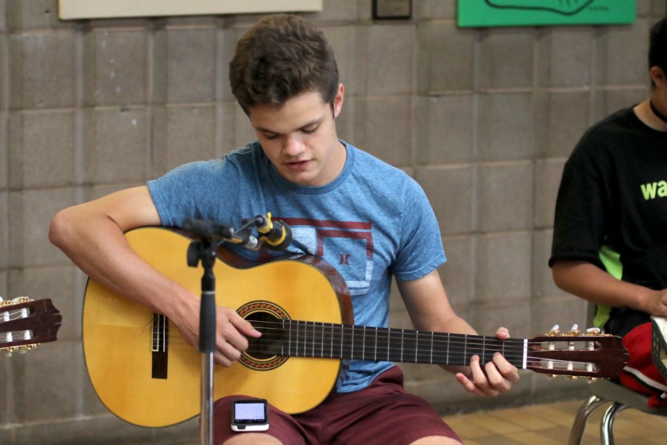 Napanee, Ont.'s Elliot Mundle, 15, performs House of the Rising Sun at a Shad Canada musical ensemble at Lakehead University on Wednesday, July 24, 2019. (Leith Dunick, tbnewswatch.com)