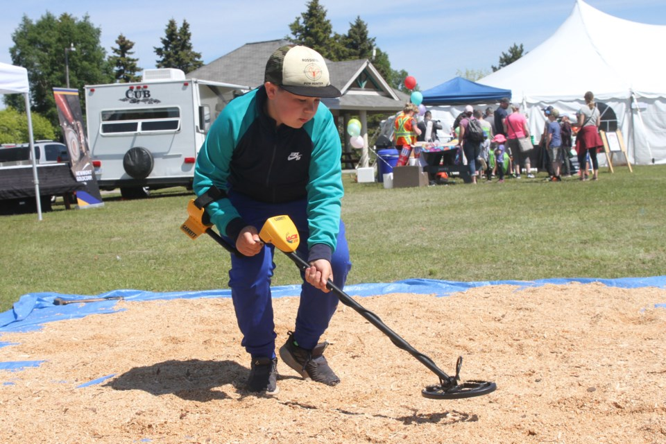 Jayce Anttila searching for treasure at Mining Day on Saturday June 22, 2019. (Michael Charlebois, tbnewswatch)