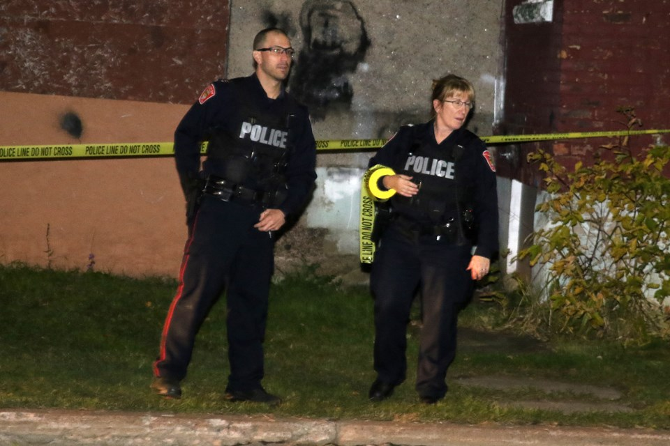 Thunder Bay Police investigate an incident at a residence on the corner of Dease and McKenzie streets on Tuesday, Oct. 8, 2019. (Leith Dunick, tbnewswatch.com)