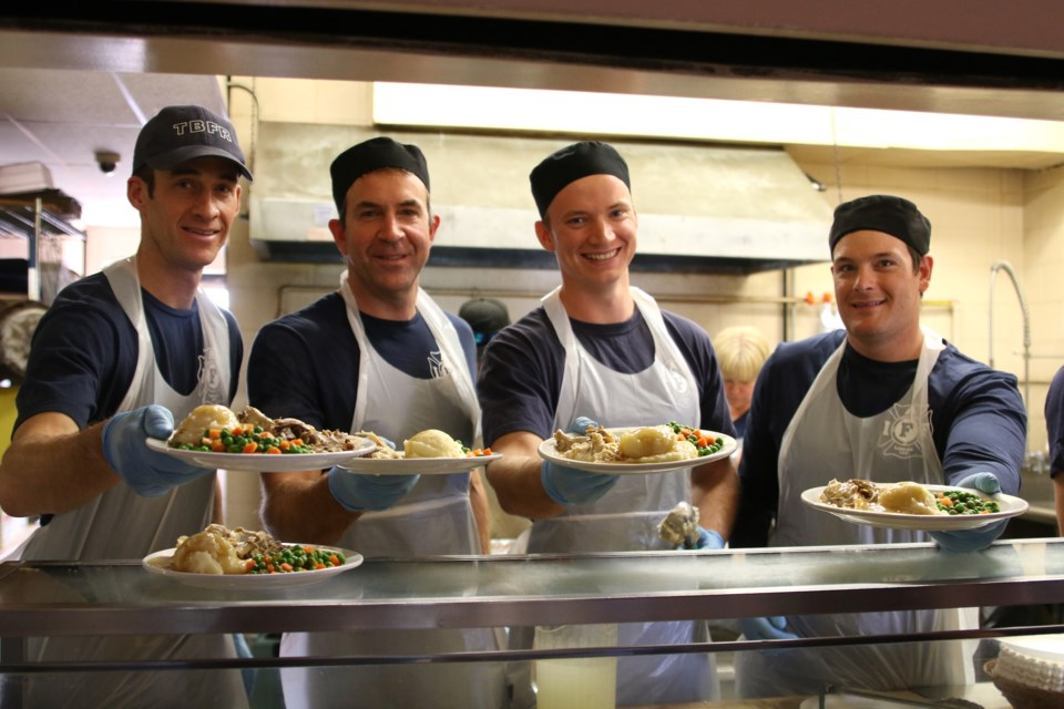 From left to right: Thunder Bay Fire Rescue members Matt Agar, Greg Stiletto, Rob Sheppard, DJ Folino were busy serving up a Thanksgiving feast at the Salvation Army on Sunday. (Photos by Doug Diaczuk - Tbnewswatch.com).