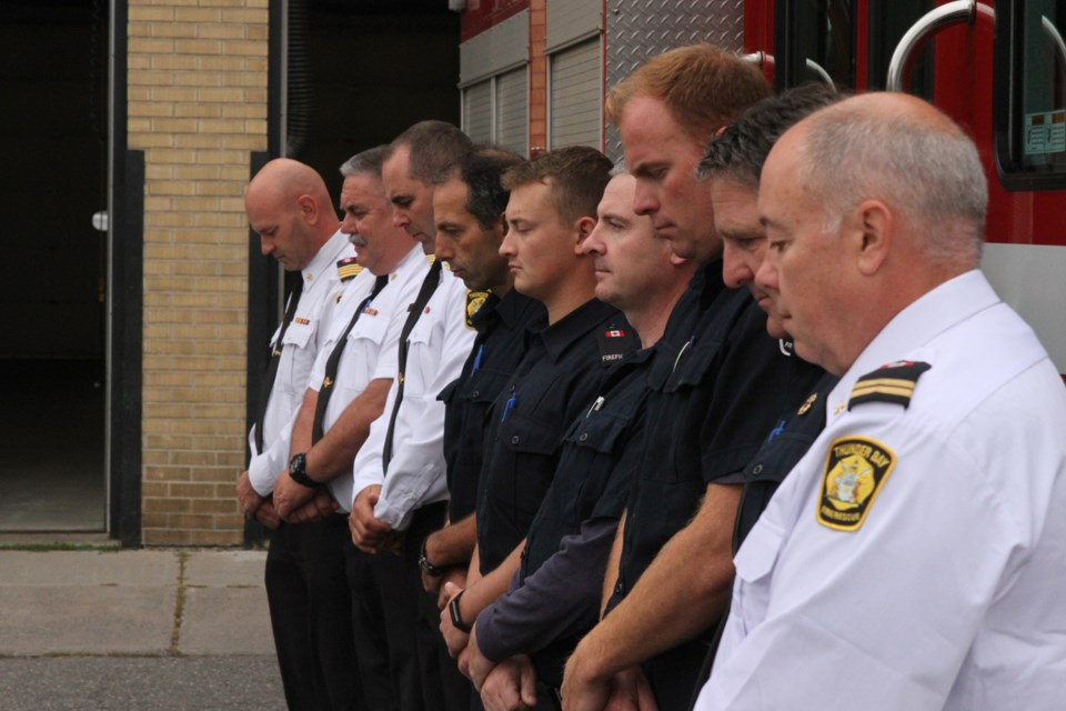 TBFR officials pay their respects to the fallen firefighters of the September 11 attacks. (Michael Charlebois, tbnewswatch)