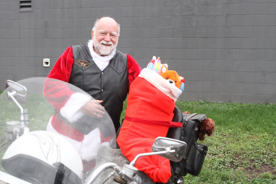 Michael Abbott wears a Santa costume and completed the ride with a stocking of toys. (Michael Charlebois, tbnewswatch)