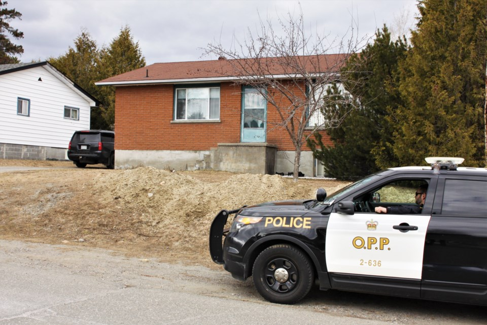 Police maintained a presence at a Duluth Street residence through much of the day Saturday. (Photos by Ian Kaufman, tbnewswatch.com)